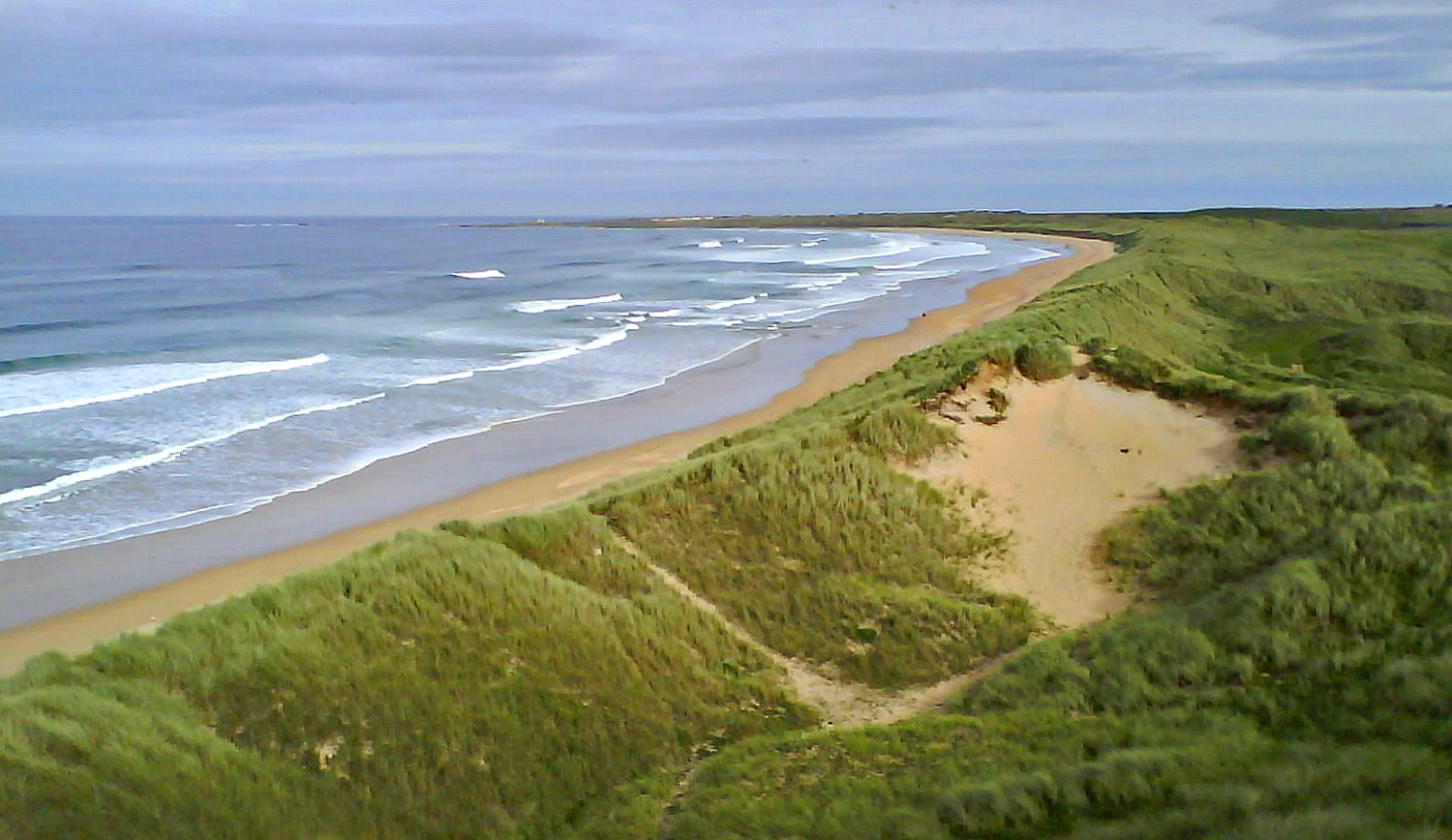 Fraserburgh beach, looking east round the bay to the village of Cairnbulg.