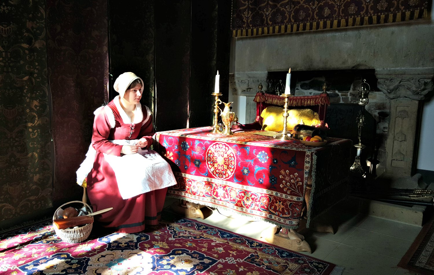 A costumed guide in the restored palace of James V.
