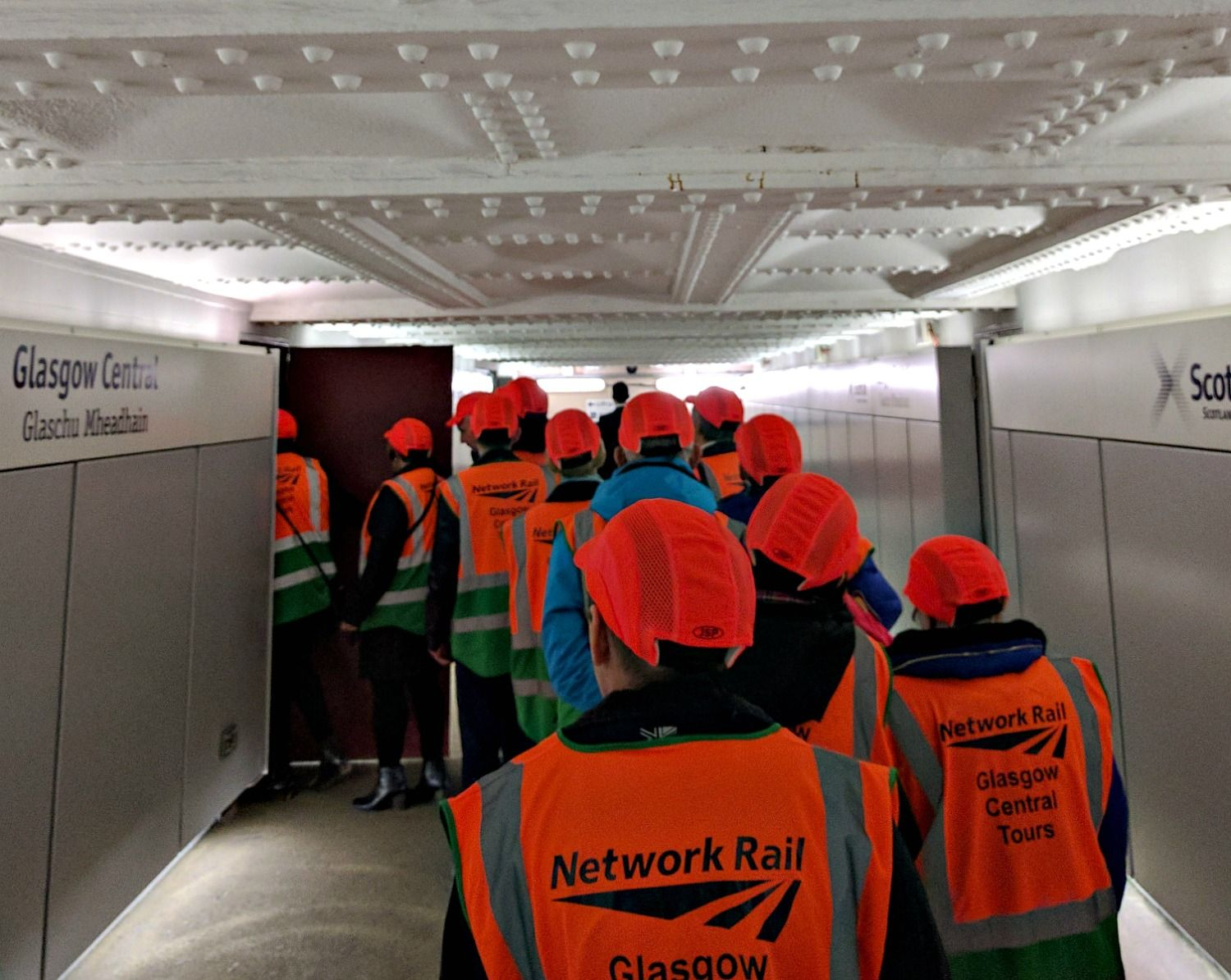 A door is opened - and we disappear into the depths of Glasgow Central Station on our guided tour. And we feel really important in our high-viz jackets.