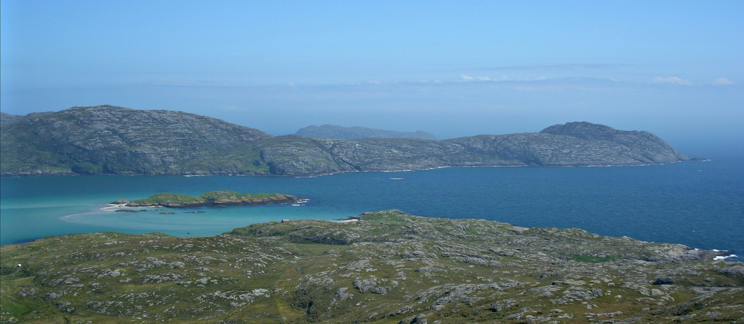 In this view, little Calvey Island lies in the sound between Eriskay (from where the pic was taken) and the south end of South Uist. The morning after the grounding, according to witnesses, a ship's boat was launched and drifted north onto the hazardous steeply shelving rocks at a spot opposite Calvey, just left of centre (and marked as Rubha Dubh on OS maps). Miraculously, all the crew got ashore, and the Eriskay ferry promptly rescued them.