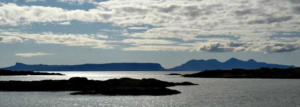 The islands of Eigg and Rum from the mainland near Arisaig