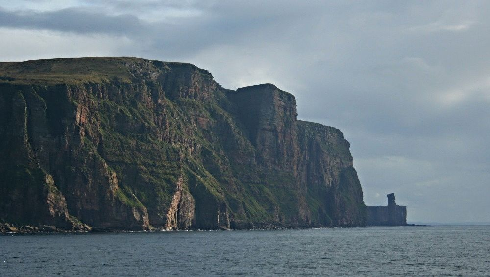 St john's Head on Hoy - with the famous sea-stack, the Old man of Hoy, on the right. photographed from the Stromness to Scrabster ferry.