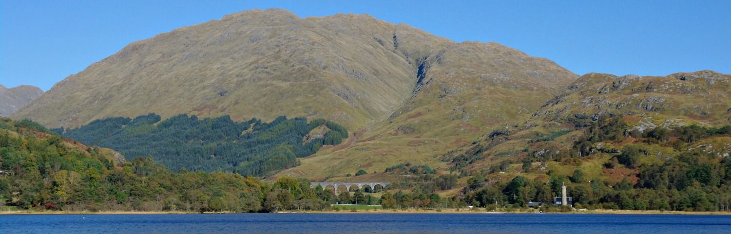 Just one of the attractions - the Glenfinnan Monument and the Glenfinnan Viaduct. View from a Loch Shiel cruise.