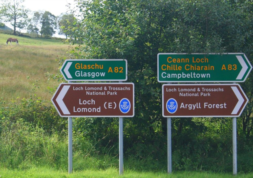 Loch Lomond signposts, within the national park. Note appearance of Gaelic.
