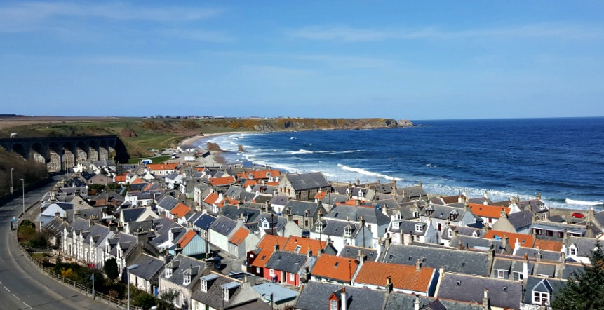 Cullen - the seatown with beach and railway viaduct walk in distance. Portknockie on the skyline.