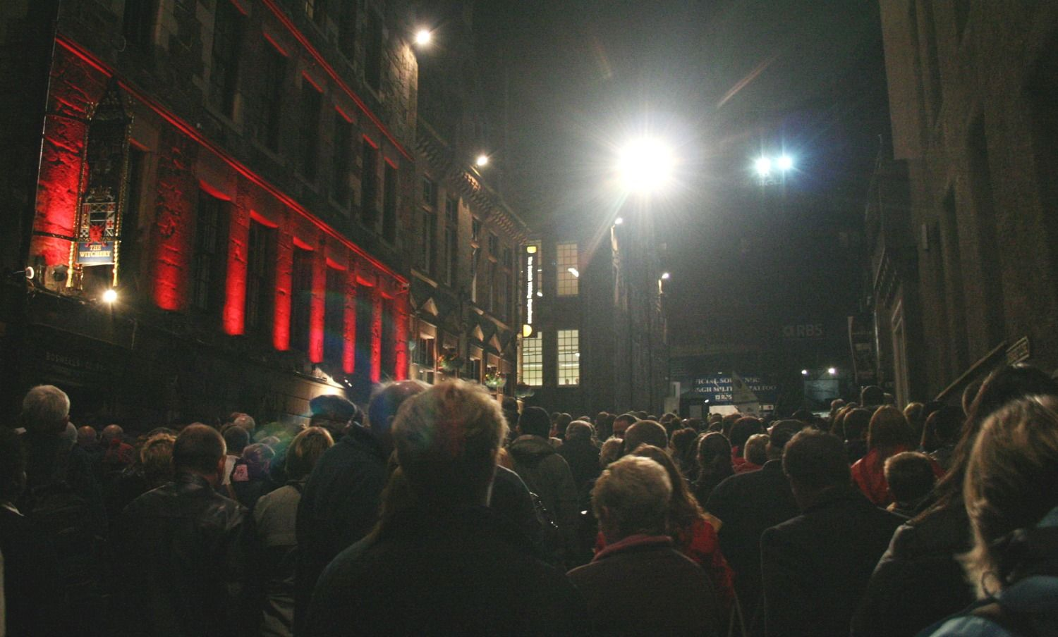 The tide surges up the top end of the Royal Mile, ready for an evening of martial spectacle and music. It's Tattoo time!