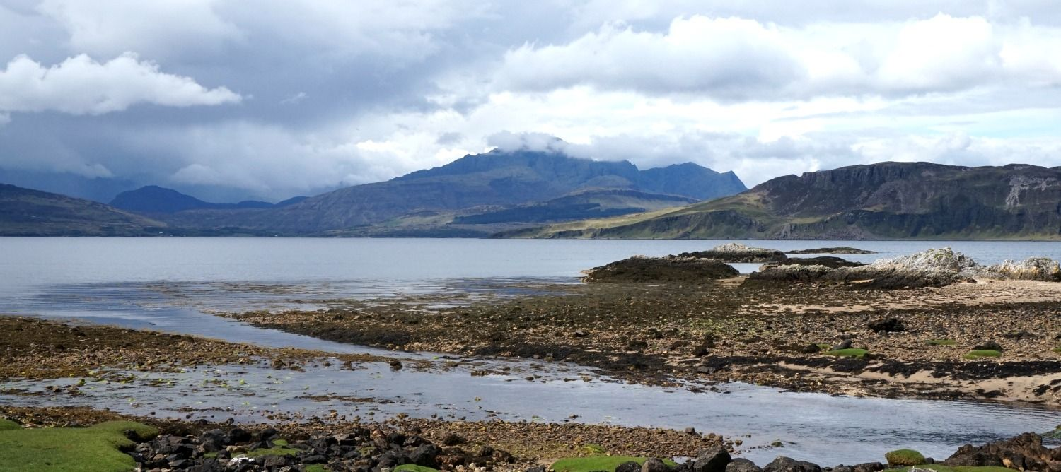 Tokavig, looking towards Blaven, cloud-topped, and the Cuillins, completely hidden, on  Skye, the 'Misty Isle' . Well, you can't blame people for wanting to visit.