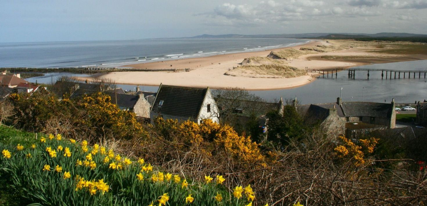 OK, the sunshine is a little uncertain on this early spring day, looking east from Lossiemouth. Can't see any railway carriages sticking out of those sand dunes (see main text). Estuary of River Lossie, looking to Spey Bay and eventually the town of Buckie. (Invisible in this picture, but trust me, it's there.)