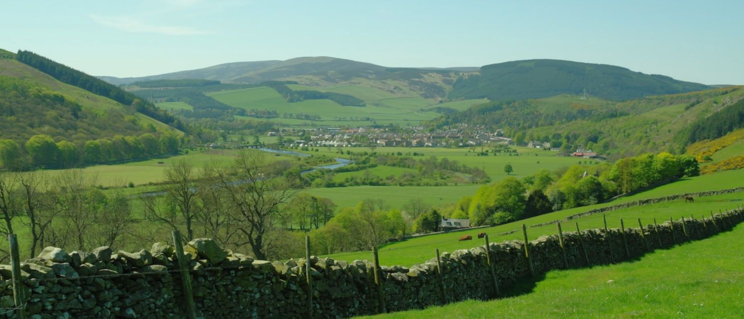 Looking west up the valley of the River Tweed from the edge of the village of Walkerburn towards Innerleithen in the Scottish Borders. DATE: 28 April 2011. OK, it's late on in the month.