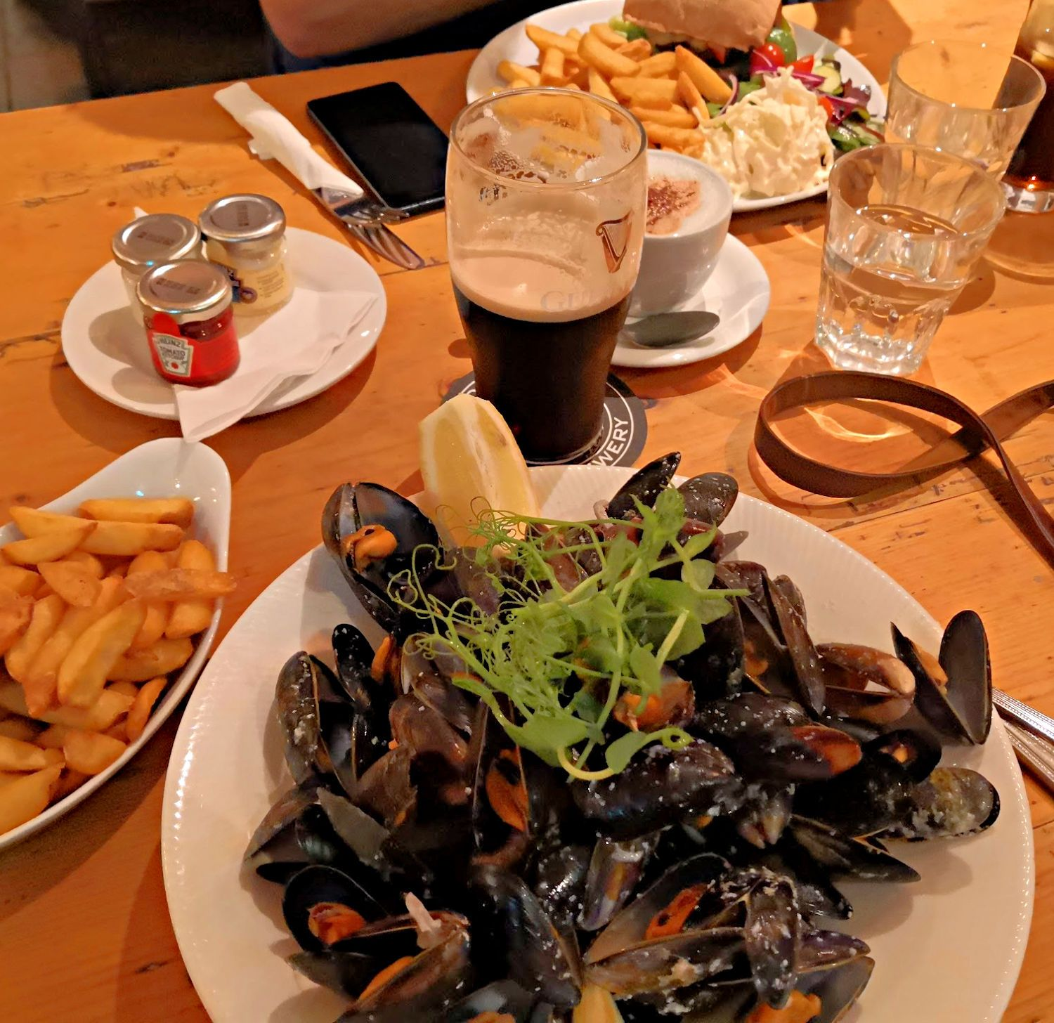 Mussels and a pint of Guinness in Guy's Bar in Clifden, Co Galway. Now, what could be better at 3 o' clock in a sunny afternoon?