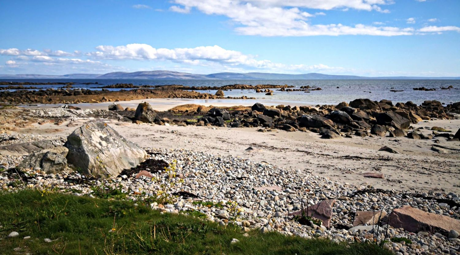 Easy to reach beach, a little way west of Galway, looking across the bay to The Burren.