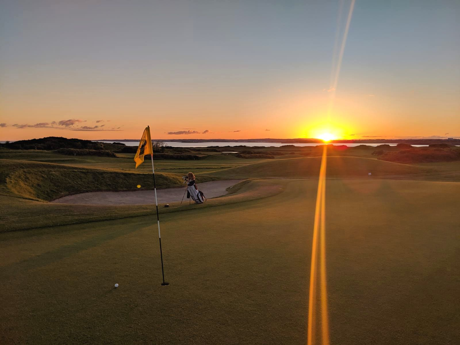 Golf in Ireland. Almost forgot. It's important. Scotland may be the Home of Golf, but Ireland is where golf goes for its holidays. Sunset at the end of a round near Galway City.  Photo: Callum Stephen.