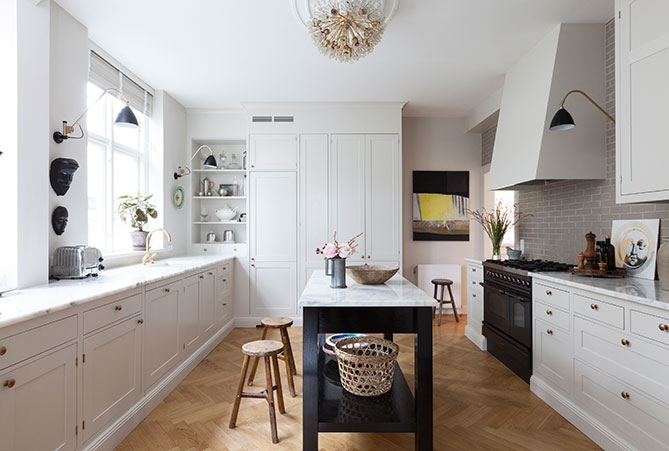 The search for the perfect tile for a white kitchen with black granite countertops.