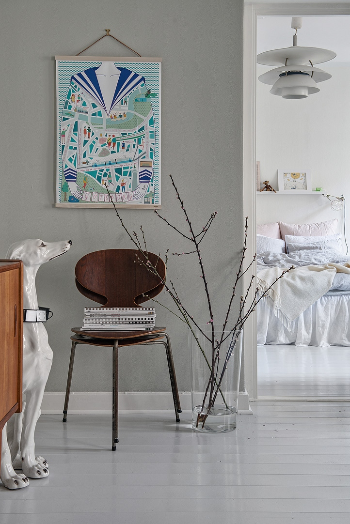 Calm greys and dark woods allow for pops of colors.