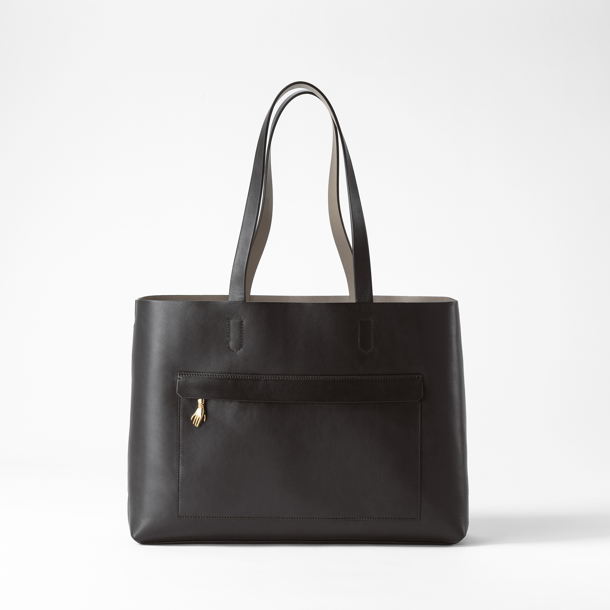Svenskt Tenn is launching a new collection of classic leather bags with brass details inspired by Estrid Ericson.