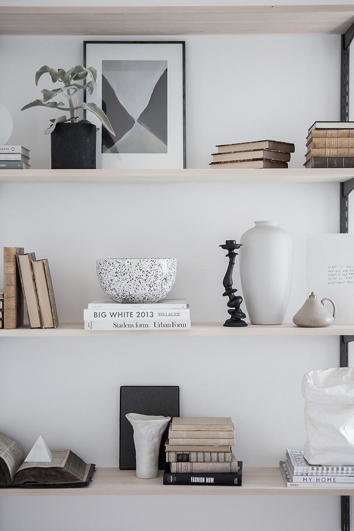 Black and blond wood shelf.