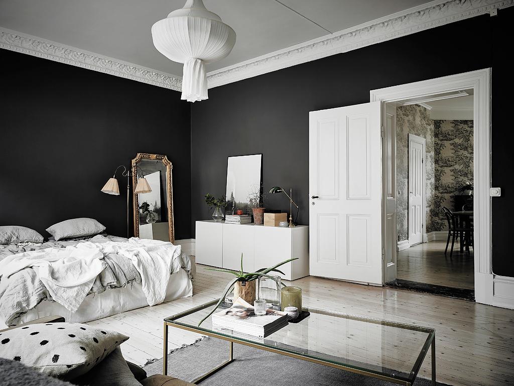 Old vintage mirror against dark grey walls.