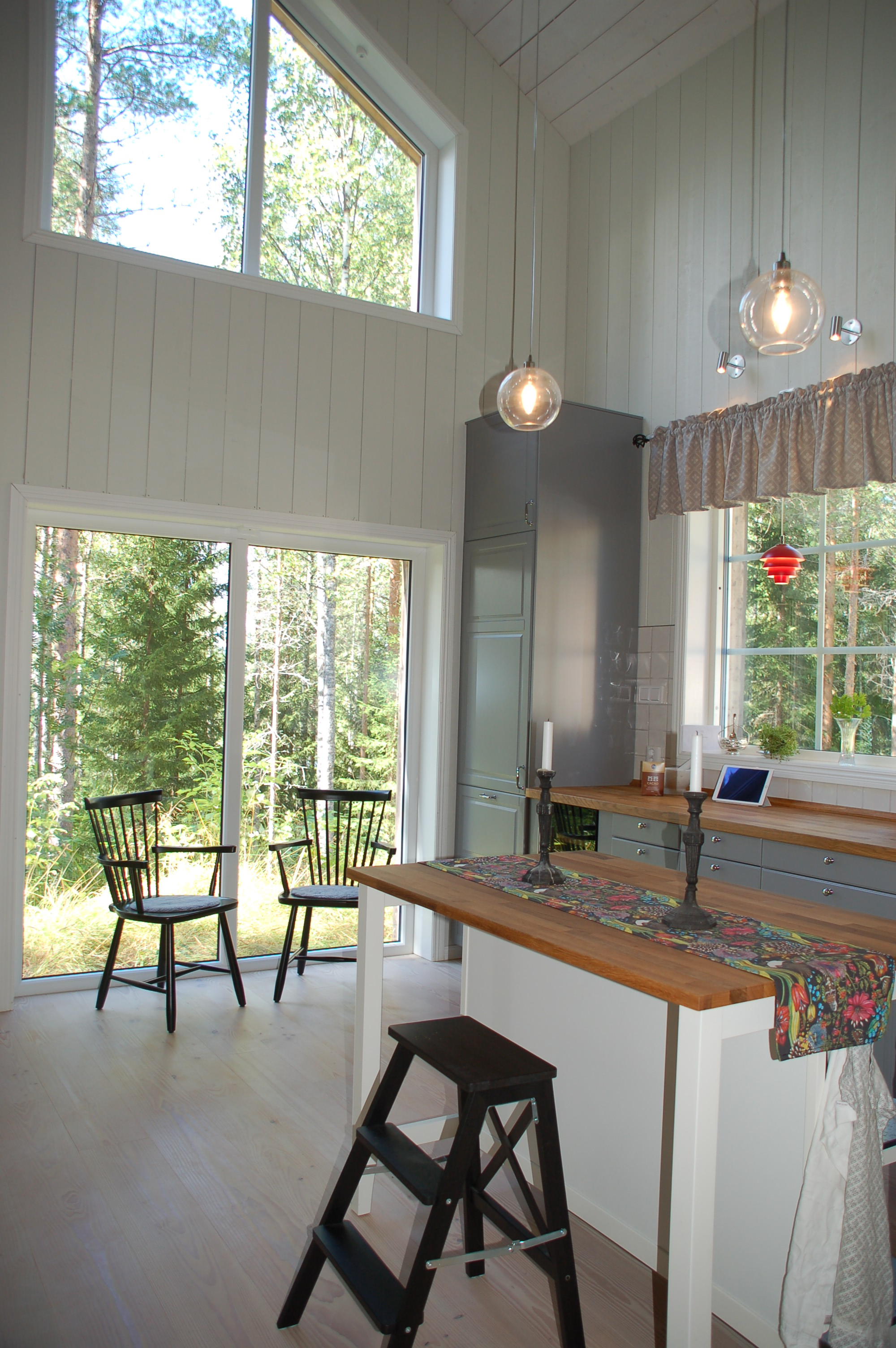 The main part of the house is the kitchen and dining area. We went with an IKEA kitchen in grey and silver.
