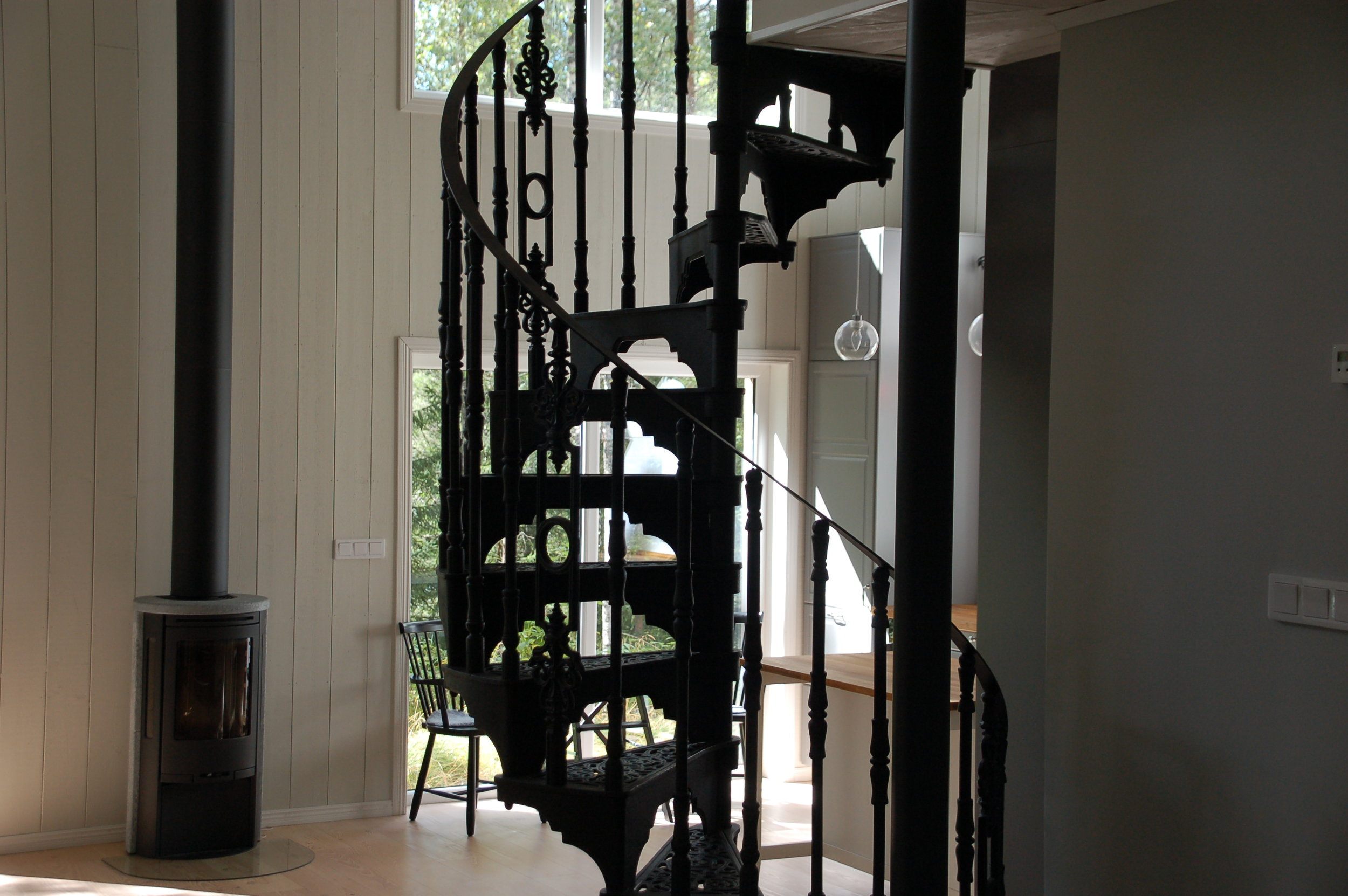 Cast iron staircase in a cabin in the woods.
