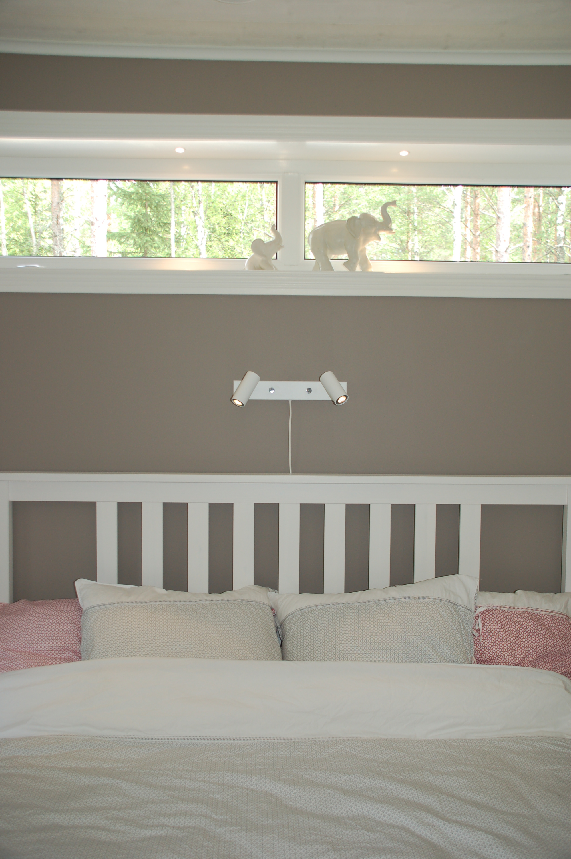 The elephants in our bedroom window used to be my grandmothers. They make me happy every time I walk in! The bedlights are called  Cato  from  Belid . Sheets from  Shyness .