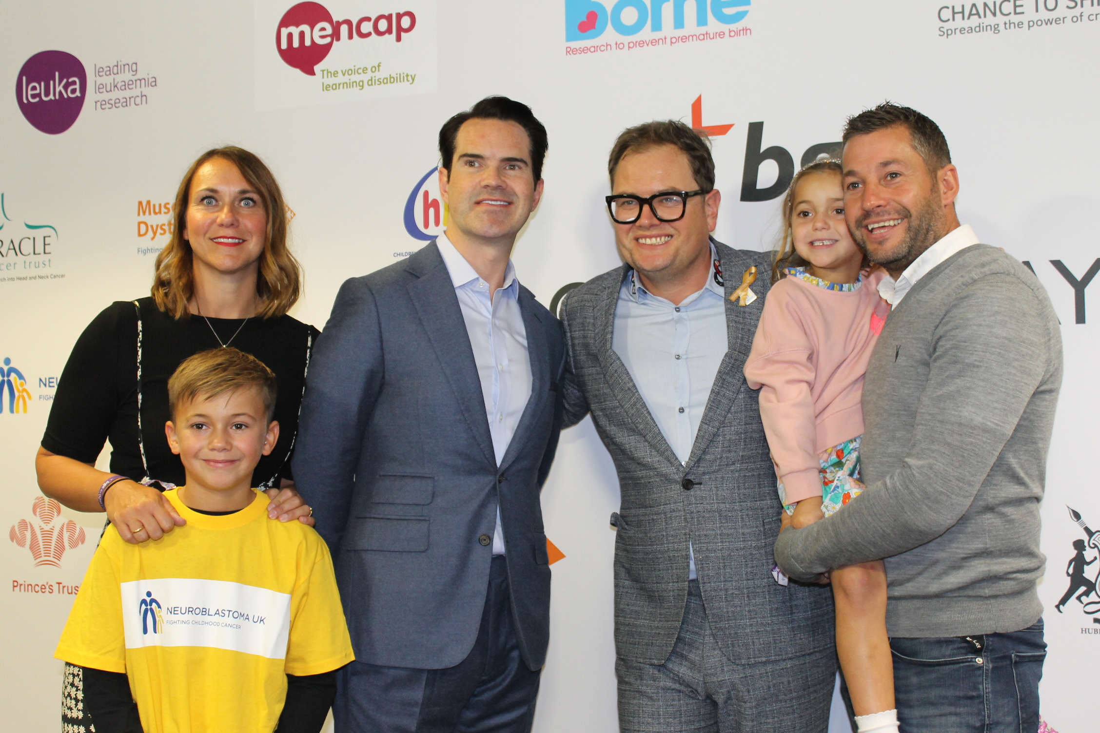 The Hughes family with Alan Carr and Jimmy Carr