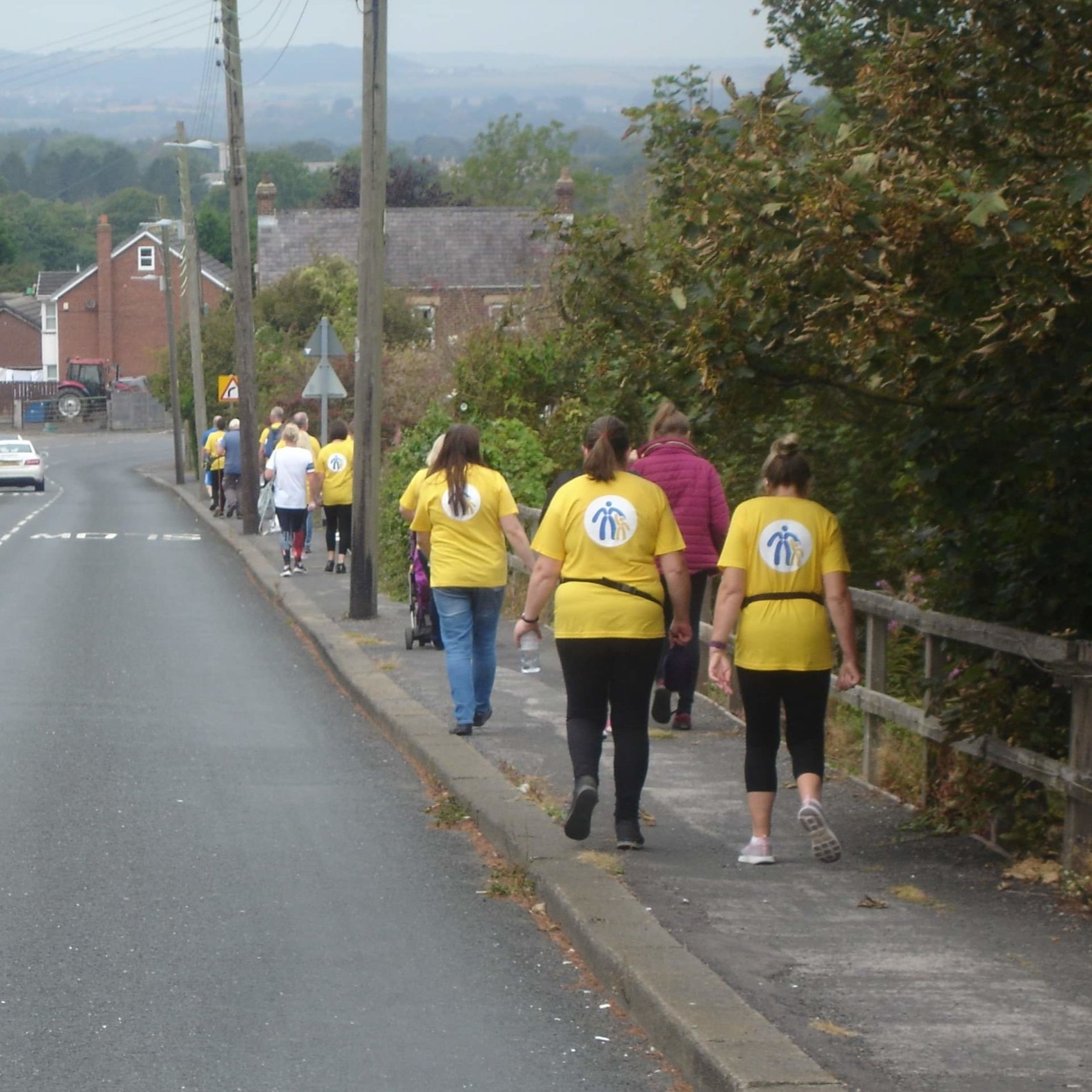 The team of 19 walked for 5.9 miles, raising nearly £1,200