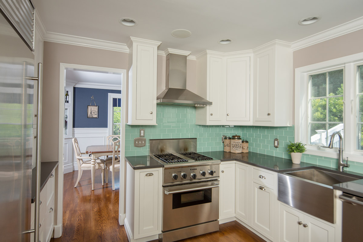 Stainless Steel Hood and White Cabinets