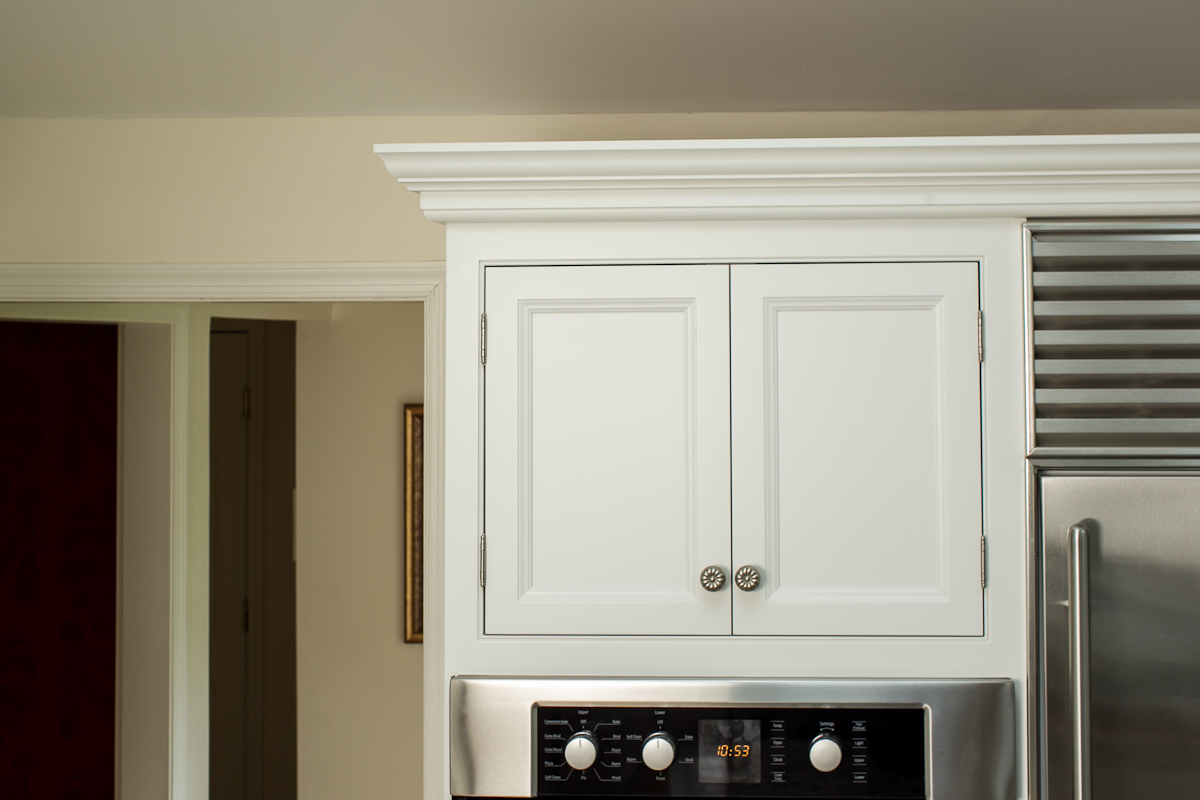 White Inset Cabinets with Stainless Subzero and Wall Oven