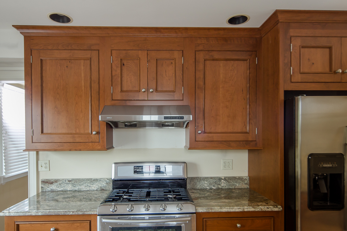 Traditional Cherry Kitchen with Stainless Appliances