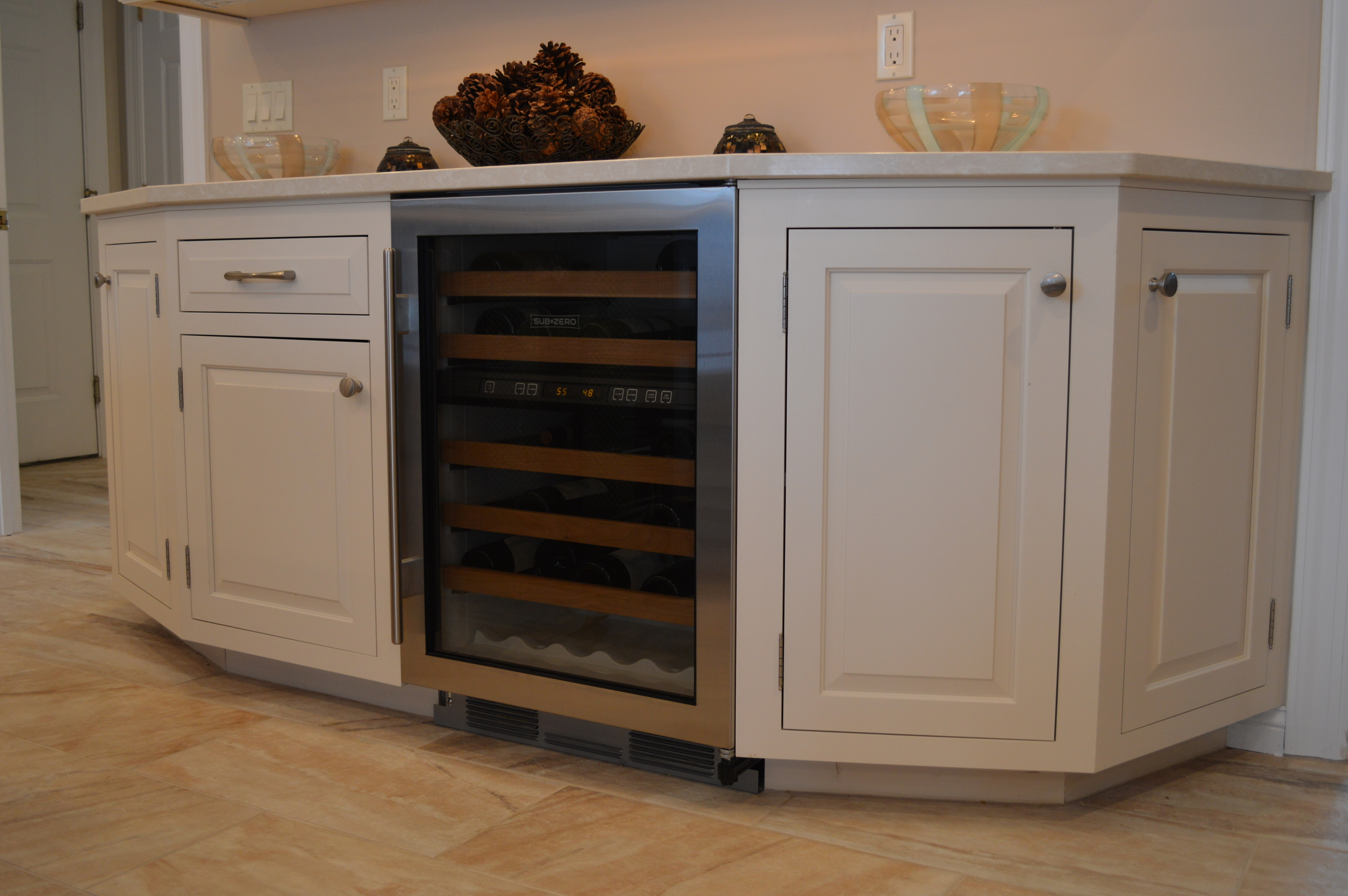 Angled White Kitchen Base Cabinets - Built in Wine Refrigerator