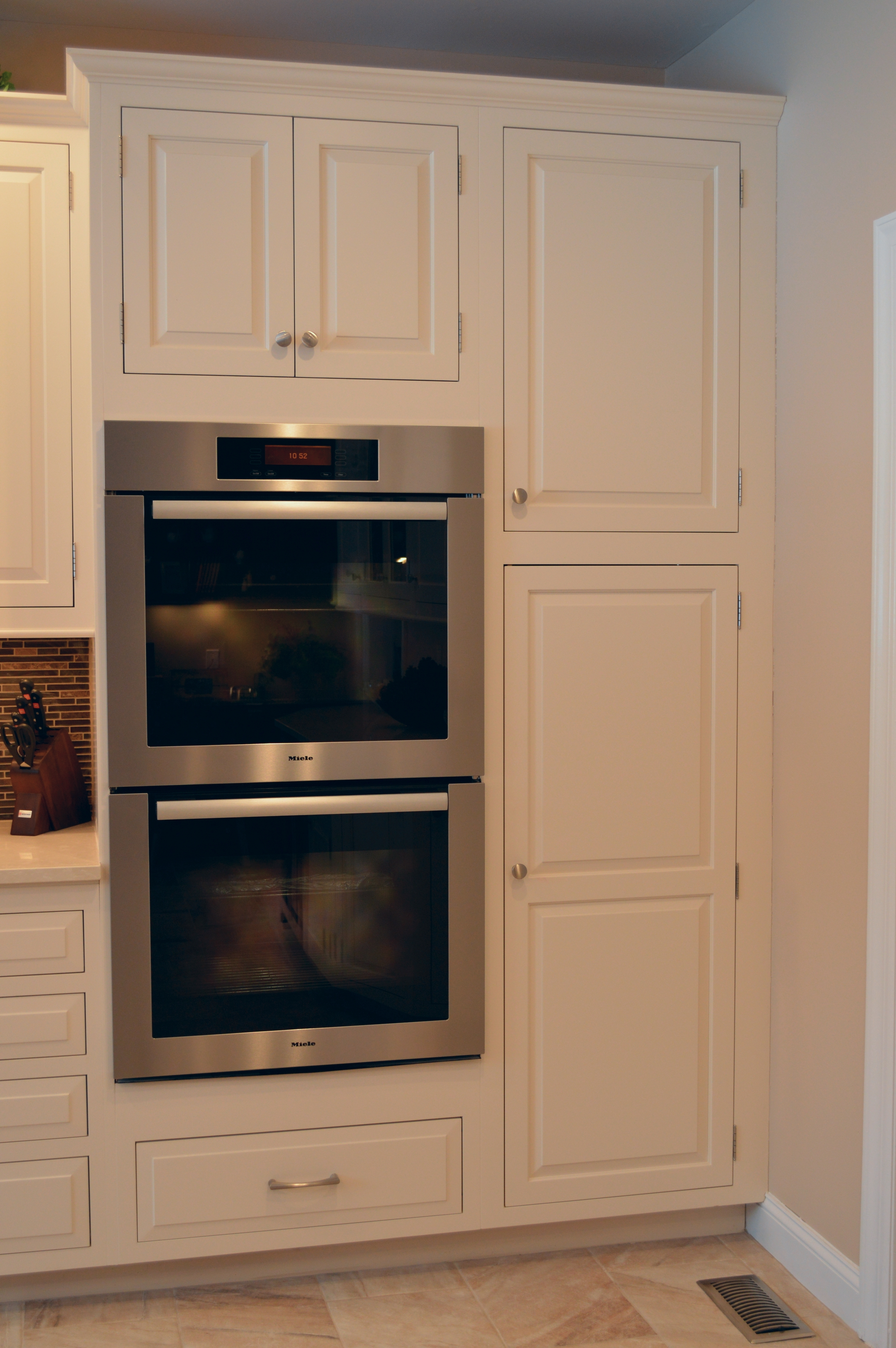 White Kitchen Cabinets - Built in Stainless Steel Double Oven