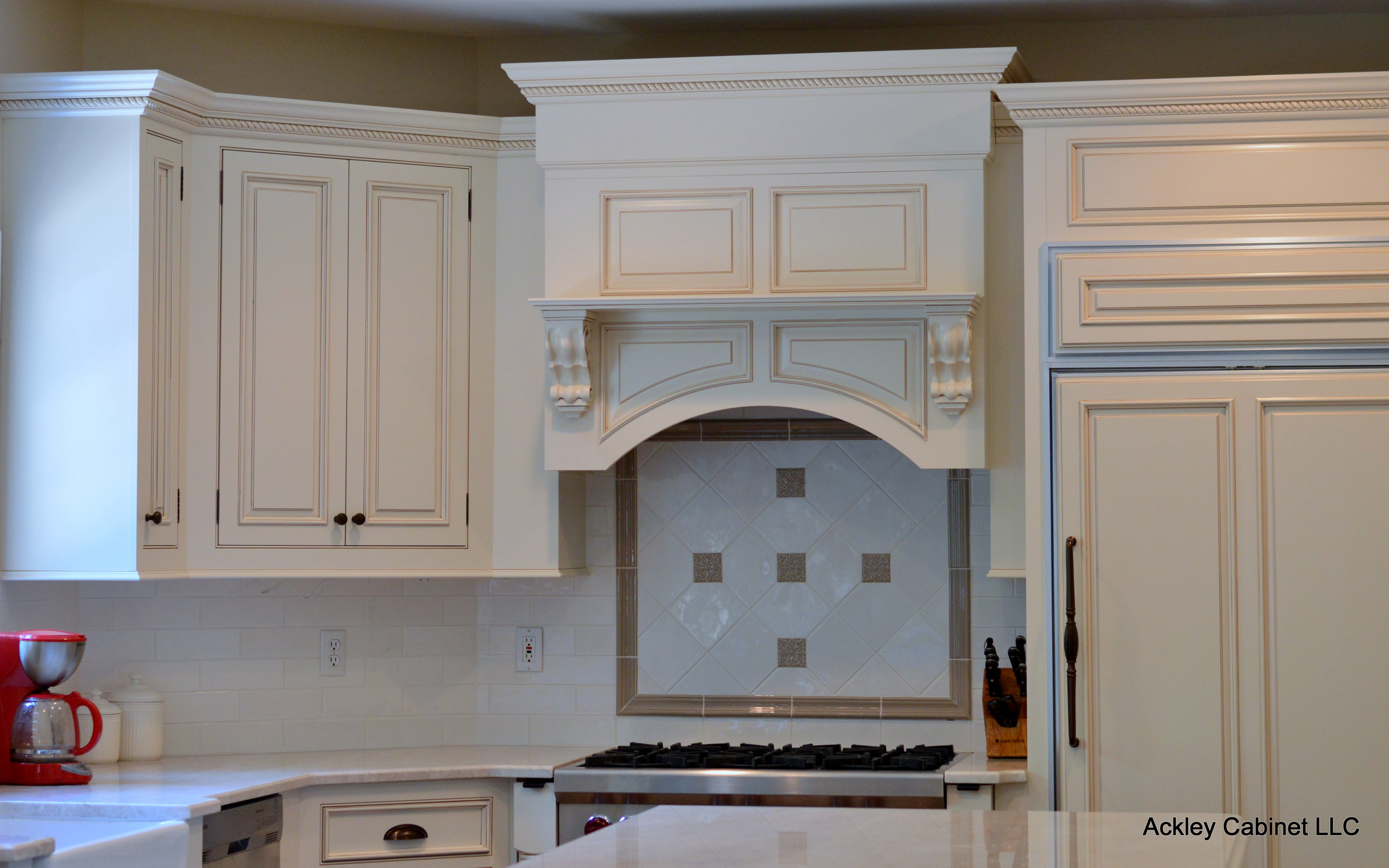 Custom Cabinet Hood and Patterned Tile Backsplash