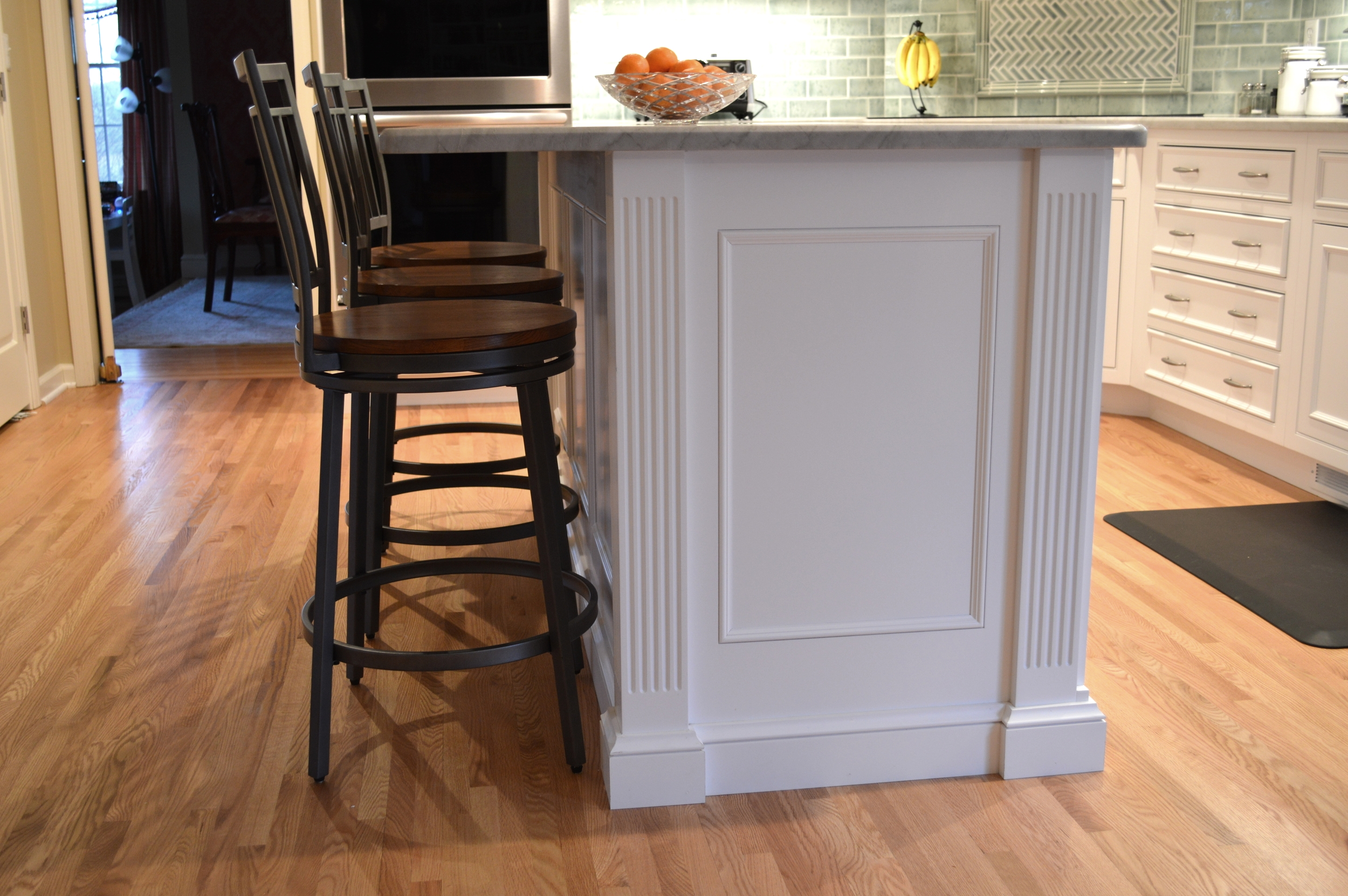 White Kitchen Island Columns and Paneling
