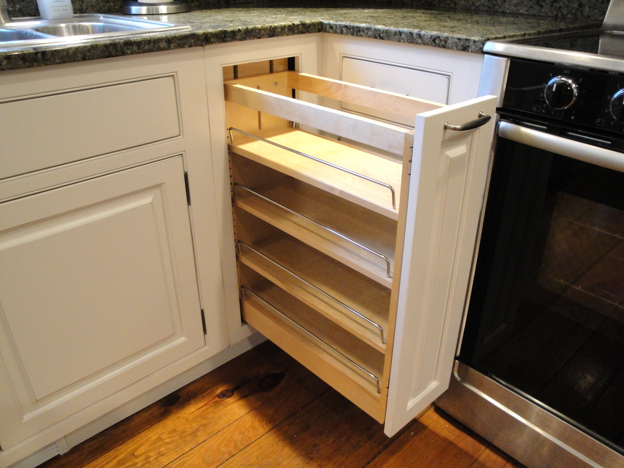 Kitchen cabinet base roll-out organizer