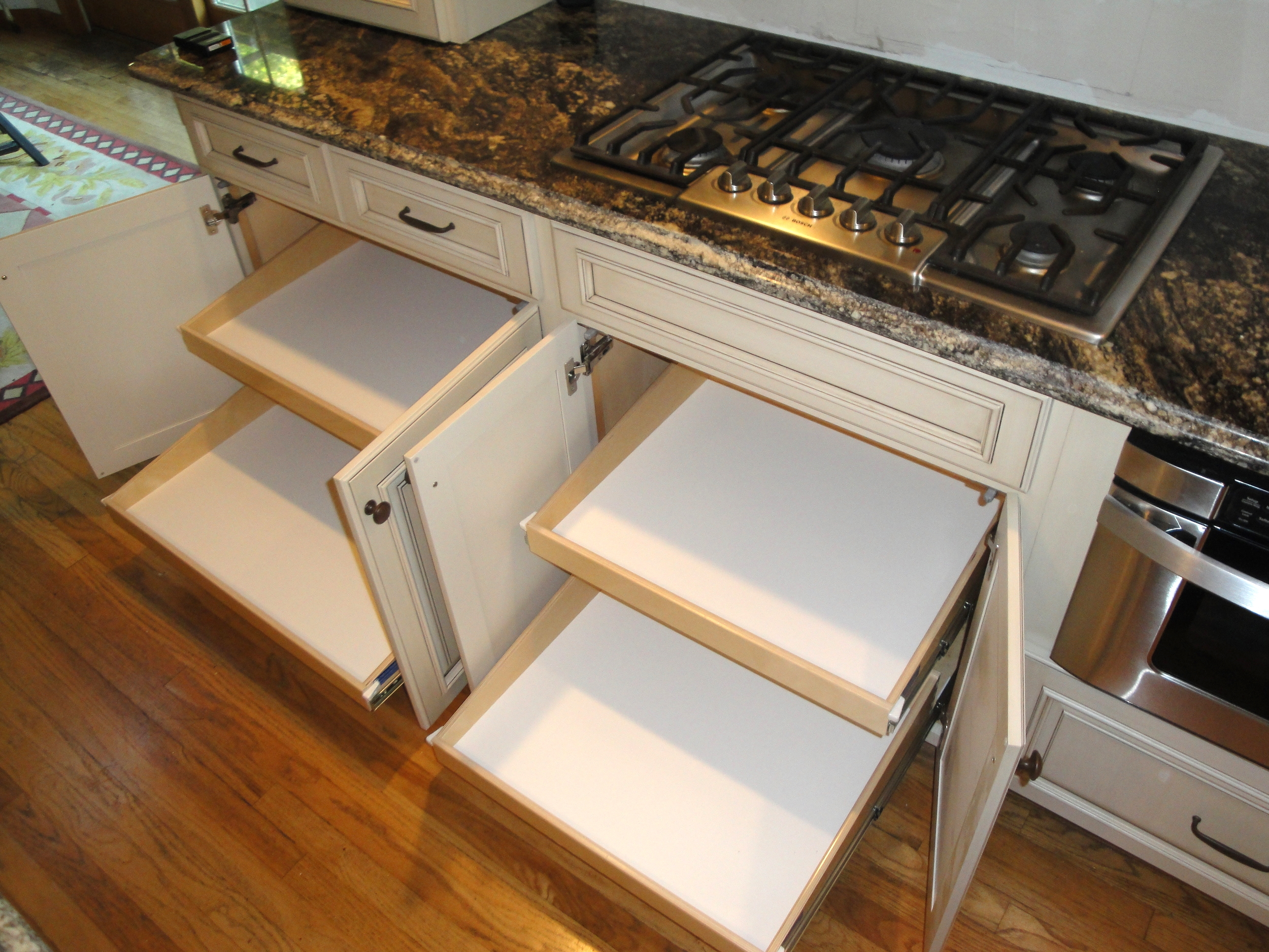 White kitchen cabinet roll-out shelves