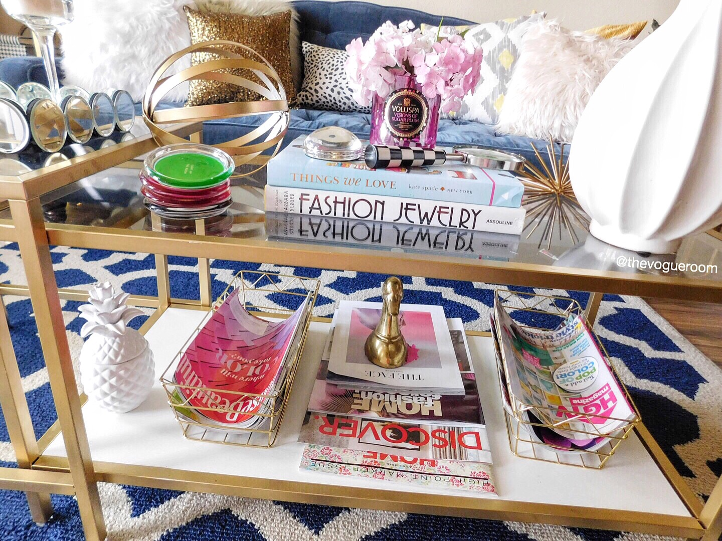 This is how I accessorize my living room coffee table. I'm always adding and changing things, but I think this coffee table speaks to my style and personality. It's so glam and I LOVE IT!