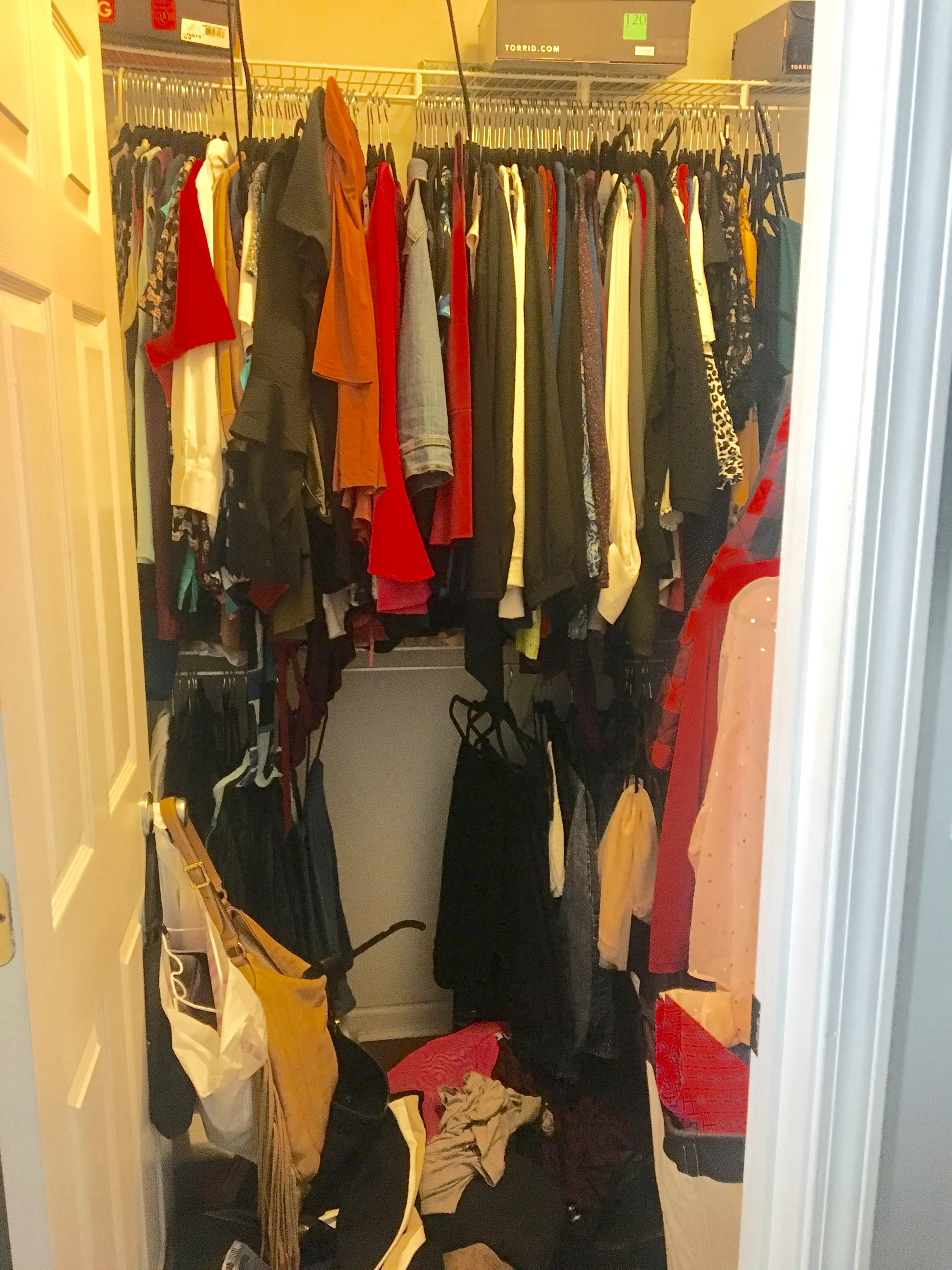 As you can see here, this is the master bedroom closet. My client clothes was growing and she needed more room and ORGANIZATION!