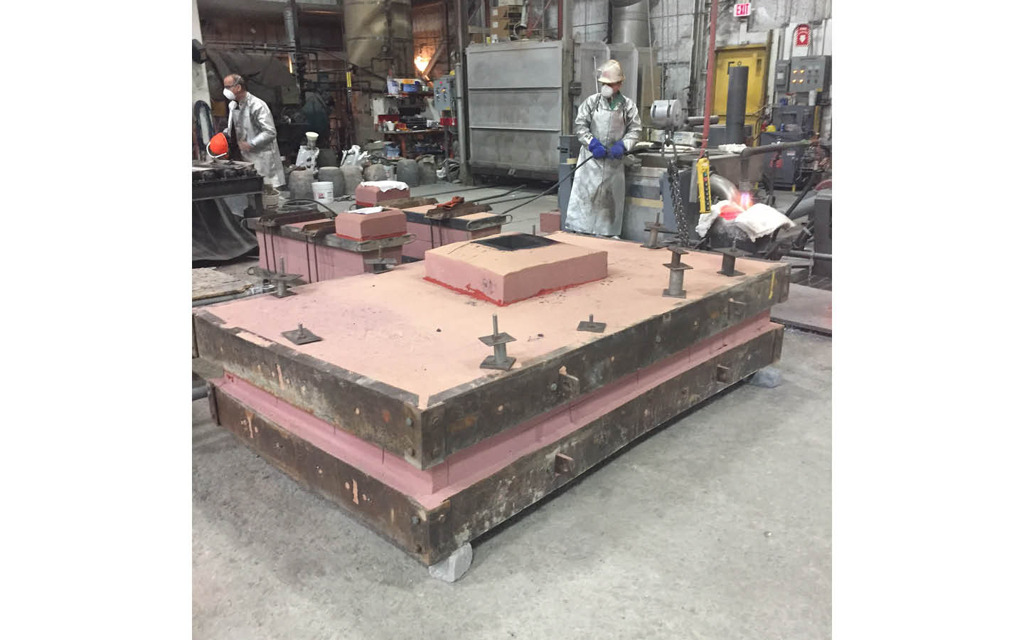 "The sand concrete mold has a top and bottom lid.  It is engineered with internal ""ducts"" so molten bronze fills the void between top and bottom before the molten metal cools"