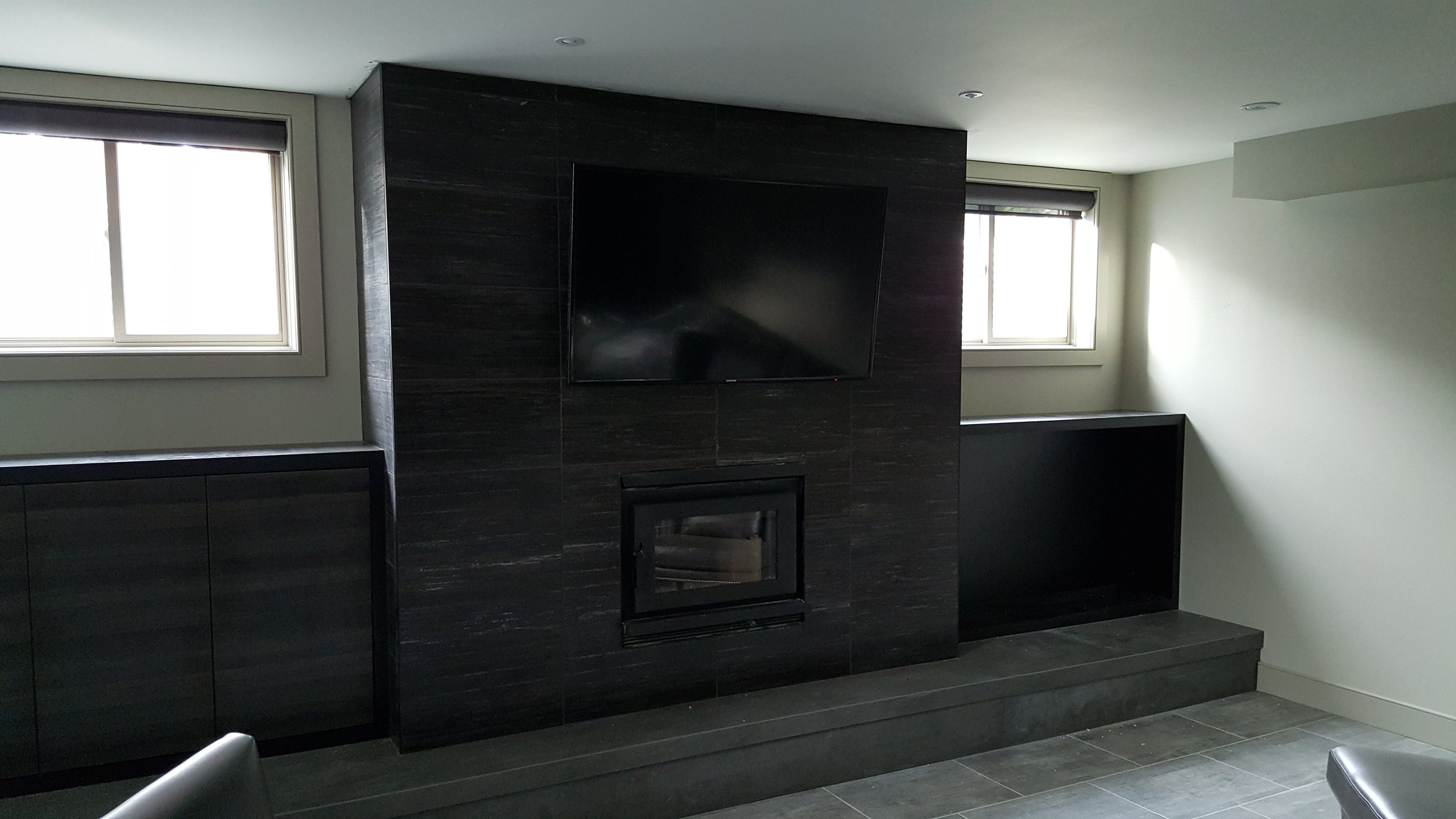 large format tile on this basement fireplace looks awesome.