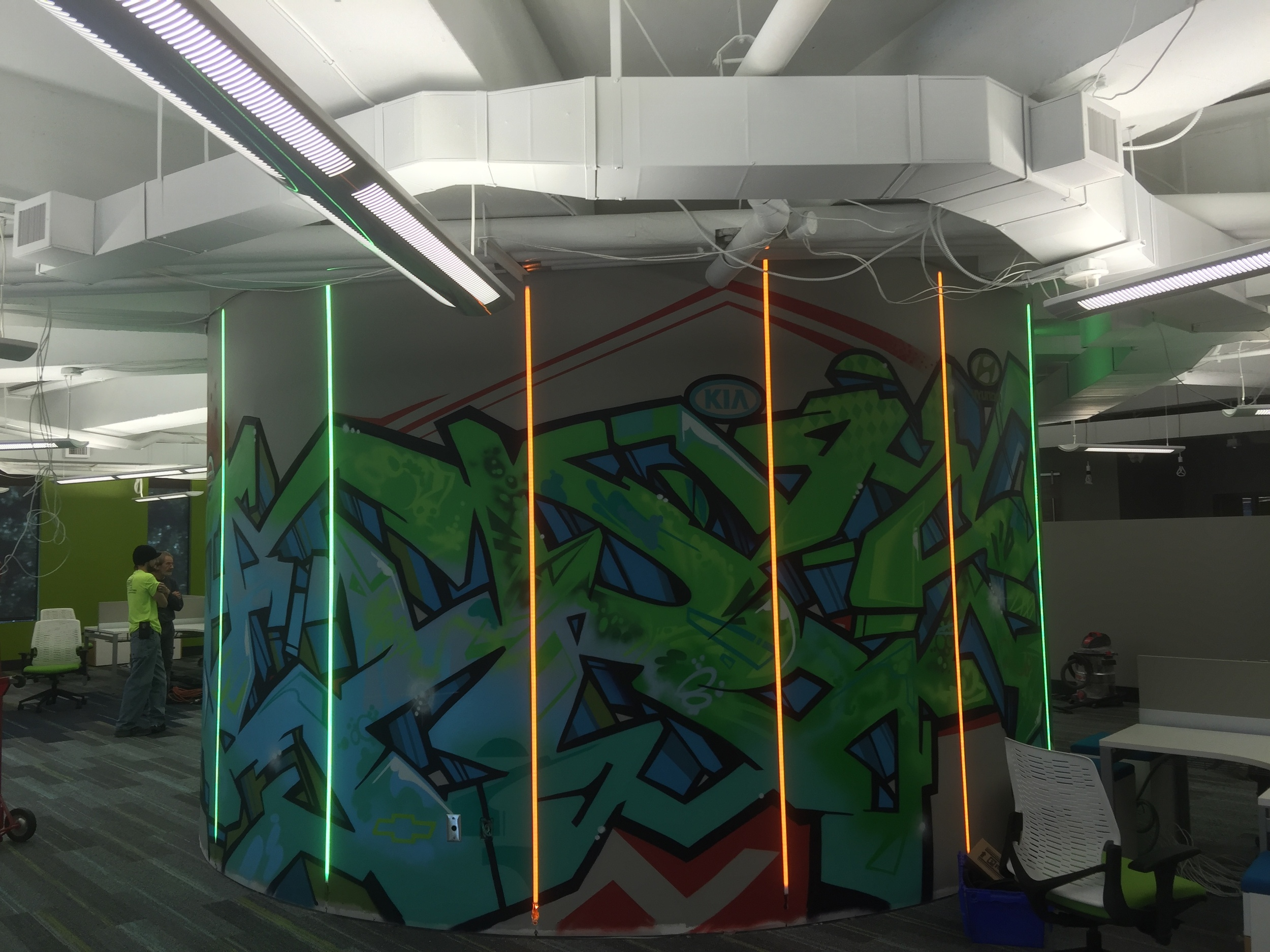 Strong Automotive's urban art within its Mountain Brook office. Embedded LEDcolor changing lighting add even more to this unique corporate art piece.