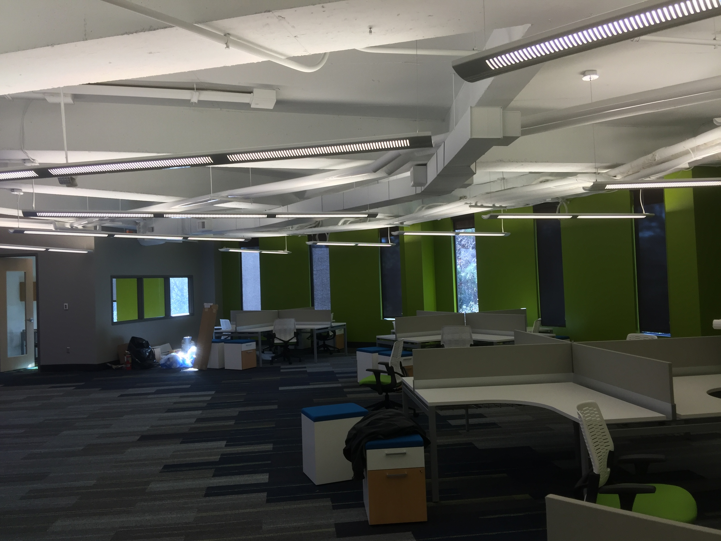 Strong Automotive's office space.....urban and simple. Lighting is clean and not too bright as it bounces off the white ceiling. This is a great work space.