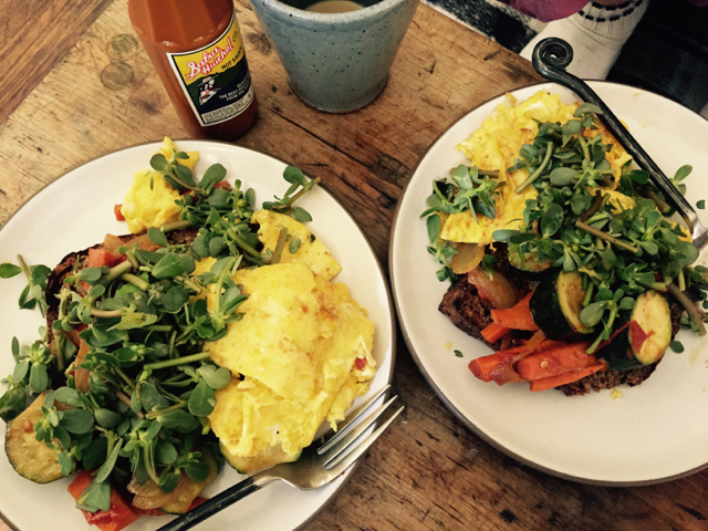 Breakfast. Eggs on toast with veggies and covered in purslane, a favorite when it's available that's high in Omenga-3s!