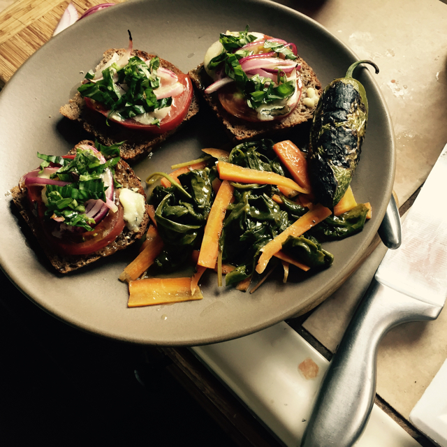 Open face sandwiches: Stoneground bread, tomato, goat cheese, basil. Seared greens and carrot side.