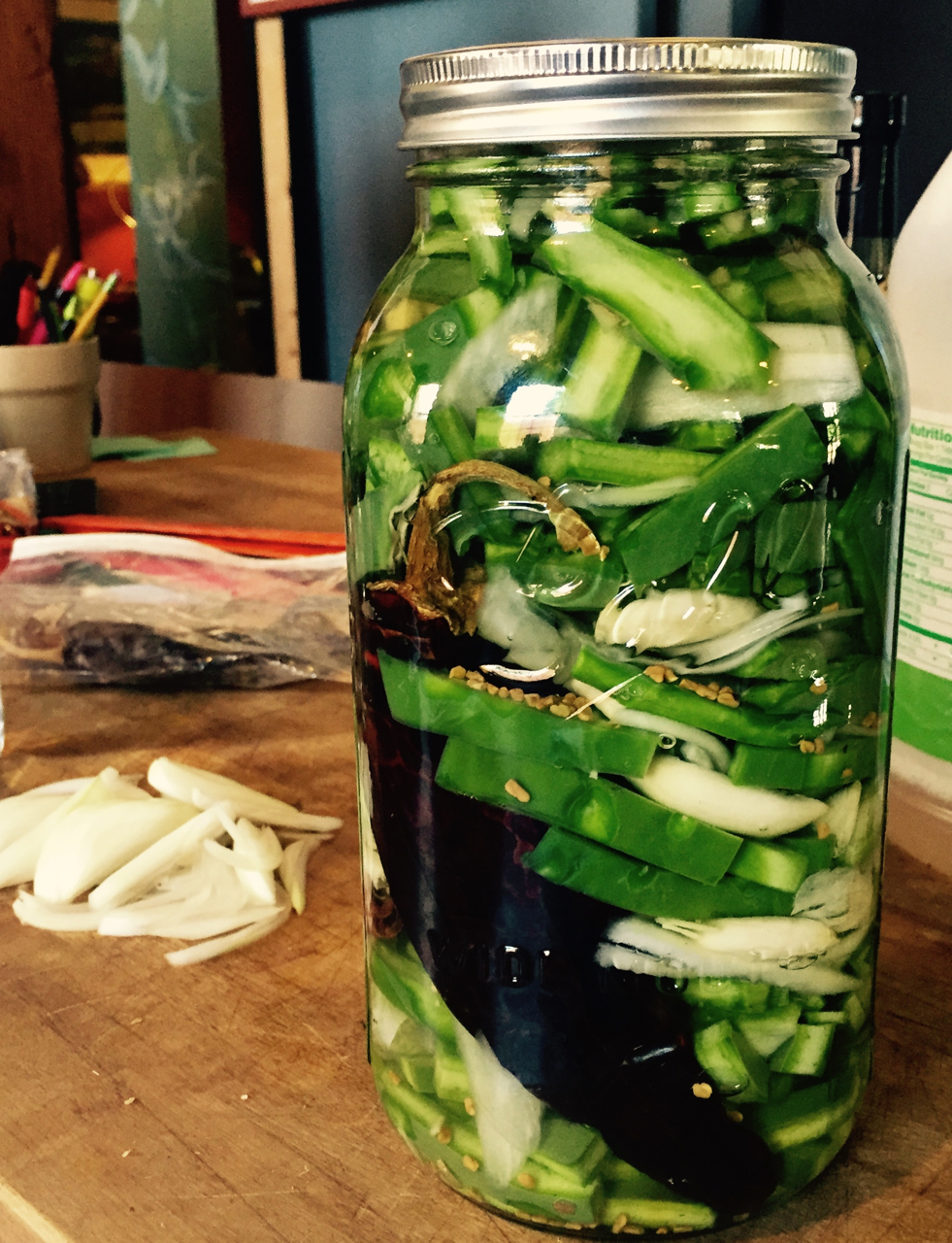 Nopales ferment with onion and chile in rice vinegar. An Ohlone Center apprenticeship creation.