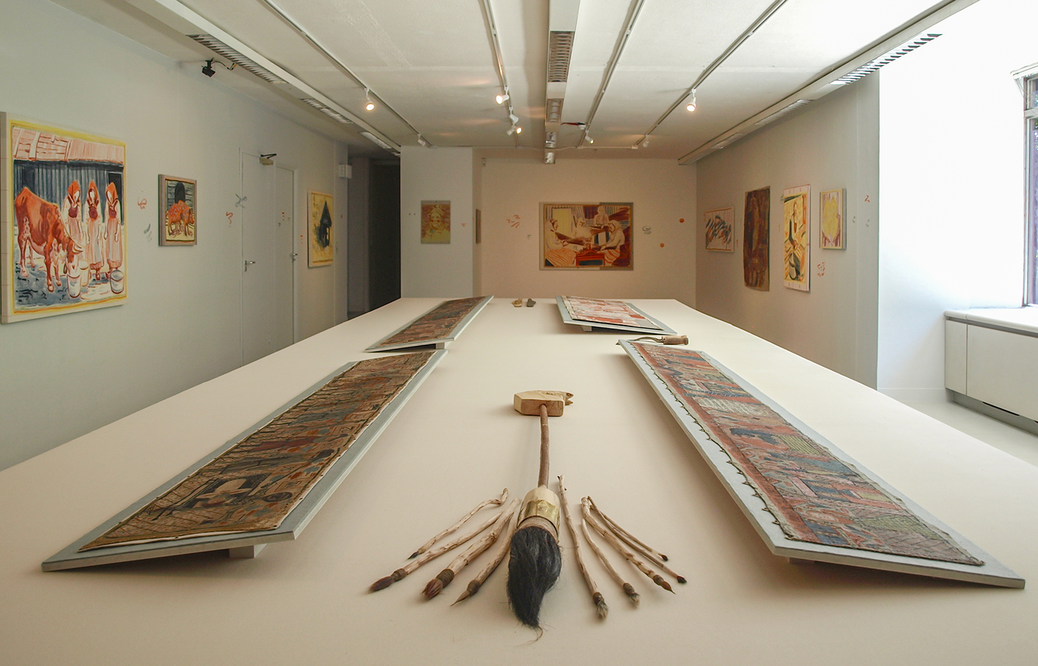 Installation shot with giant brush, brushes, farm tools and peasant paintings at ASC Gallery, London, 2014.
