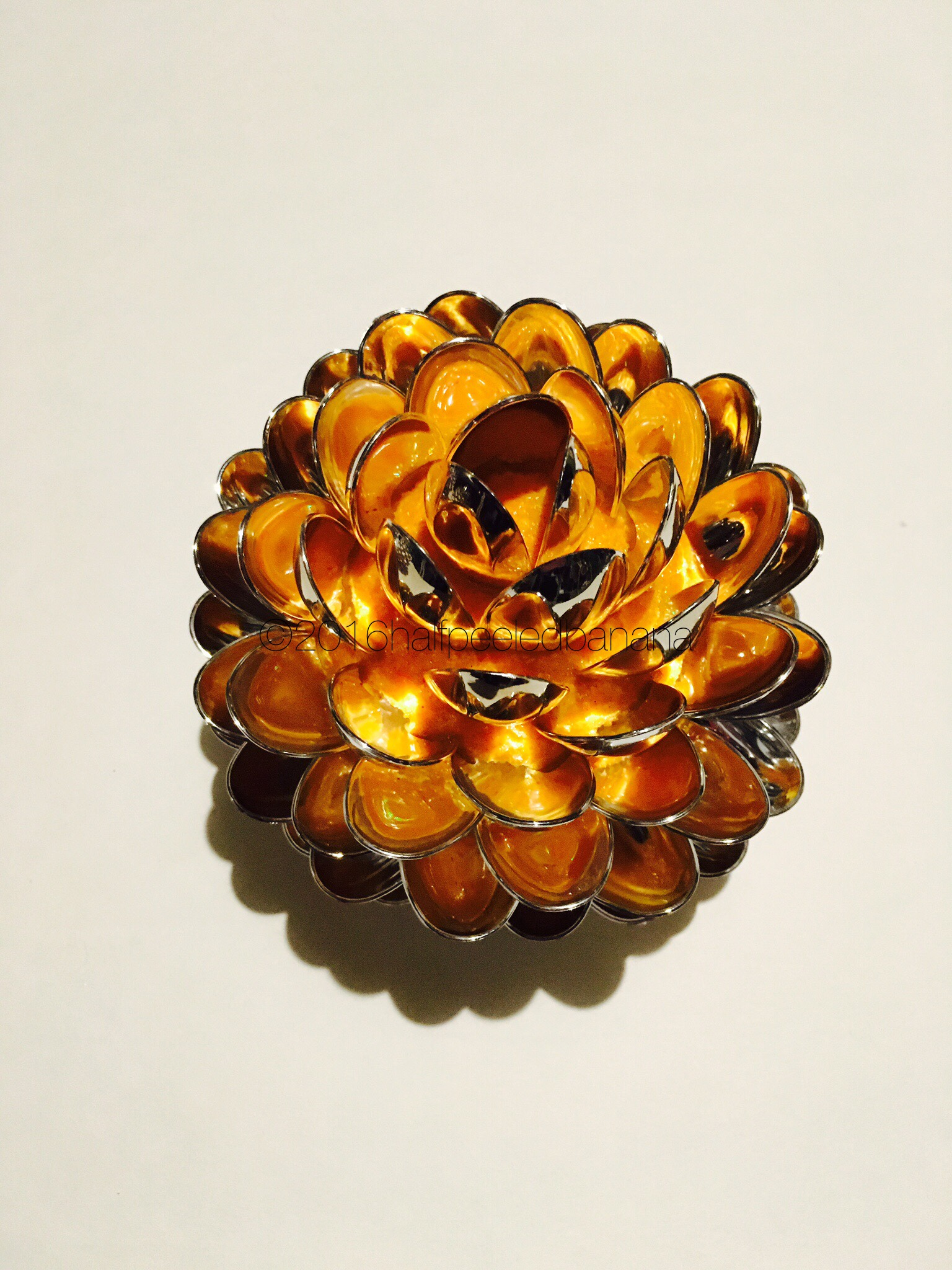 you need this!!  orange tabletop flower made from spoons!