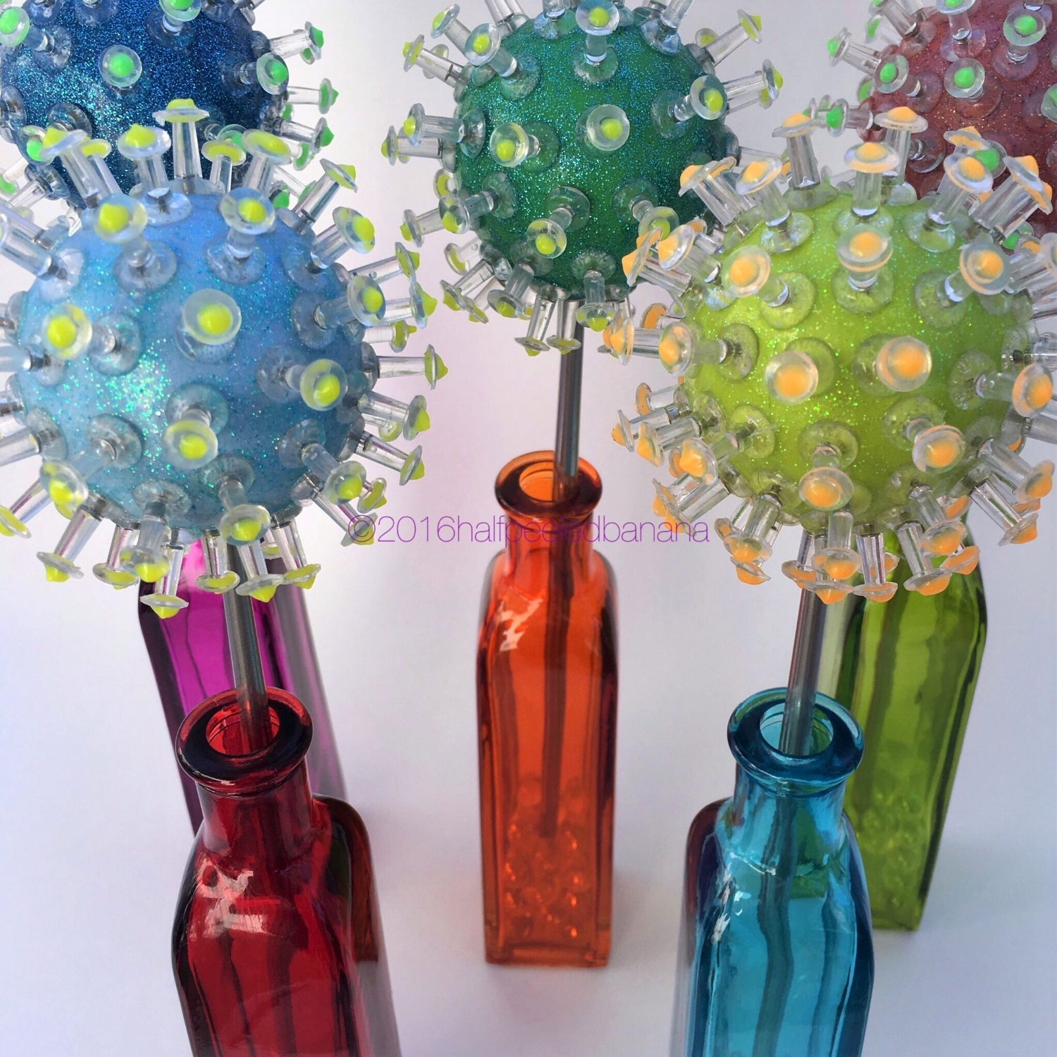 "sharp looking tabletop flowers pins style 3"" in dark blue, medium blue, dark green, lime green, and red"