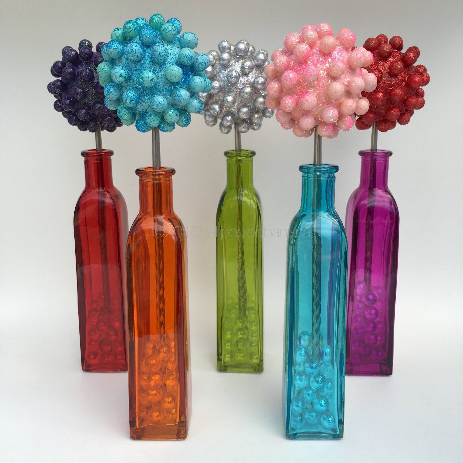 """bright tabletop flowers 3"""" nubs style in dark purple, light blue,, silver, light pink and red"""