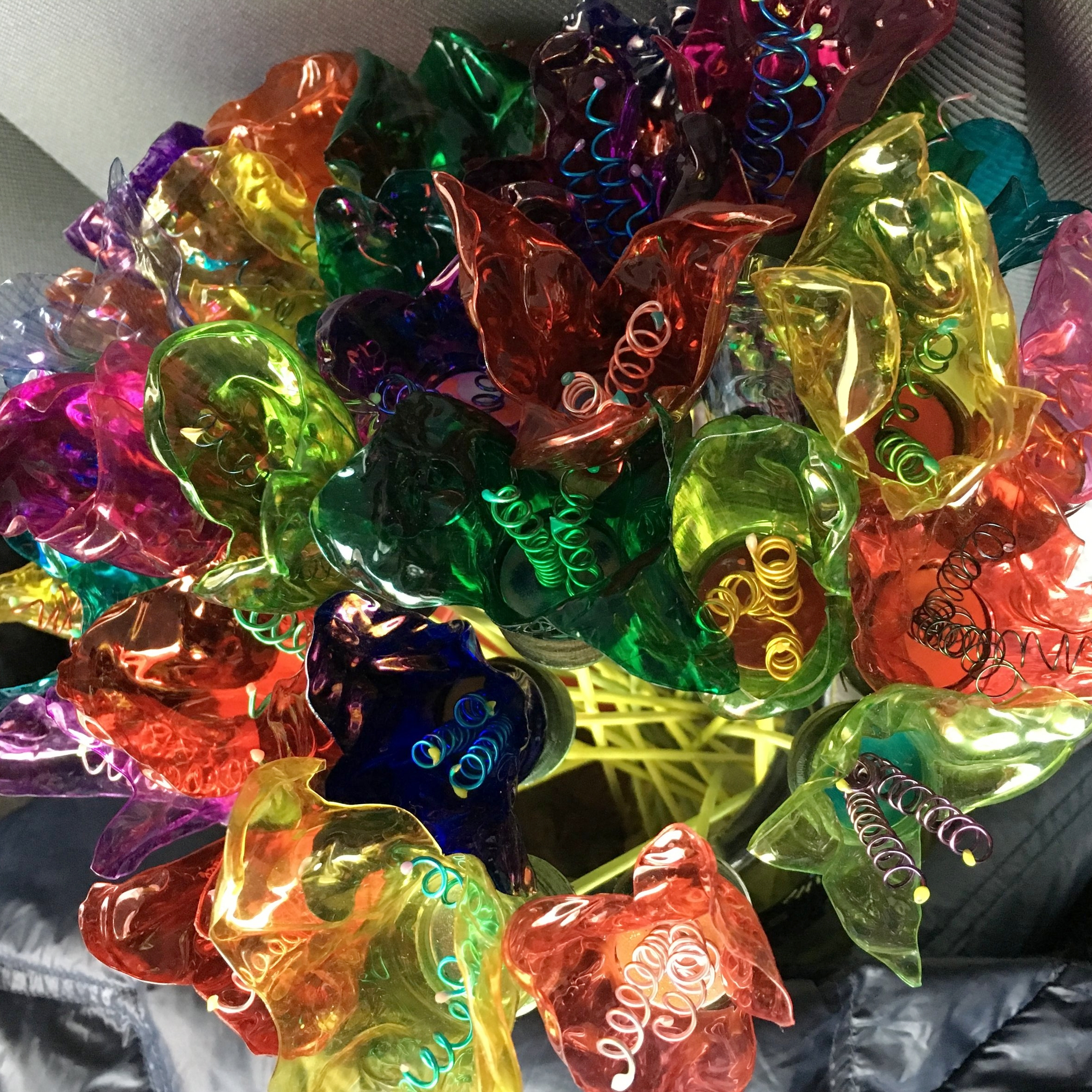 flowers made from water bottles! - The MOM in your life and the MOM of the Earth will be just giddy receiving these vibrant flowers made with upcycled water bottles!! No two are the same!!CLICK HERE TO FIND OUT HOW TO GET THEM BY MOM'S DAY!!