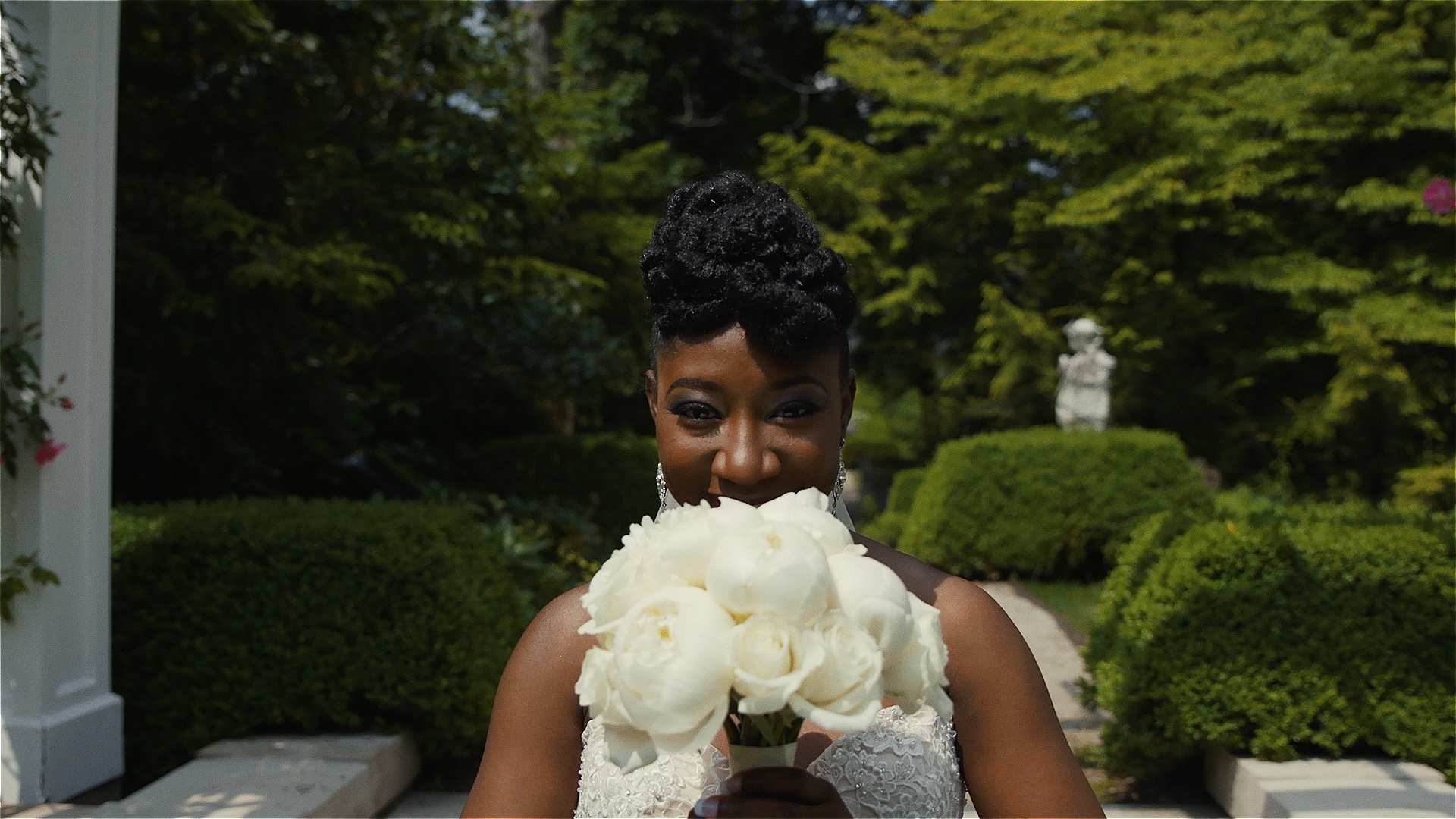 This shot was thought of on the fly, I had the Bride cover her face with her bouquet and proceed to slowly reveal her face, it came out great!